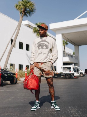 Stefon Diggs Wearing A Readymade Sweatshirt With Gallery Dep Shorts Nik Dunk Sneakers And A Louis Vuitton Bag