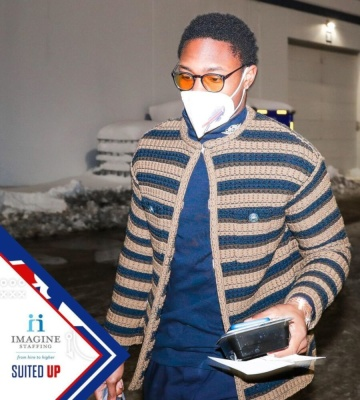Stefon Diggs Wearing Gucci Black Yellow Round Glasses With An Air Dior Mock Neck T Shirt