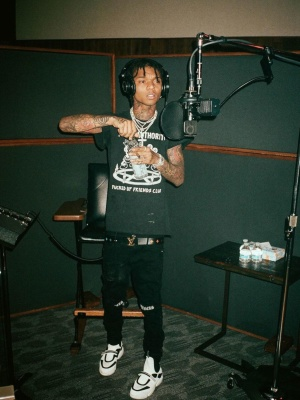 Swae Lee Wearing A Local Authority T Shirt With Rta Sinners Jeans A Louis Vuitton Belt And And Prada Sneakers