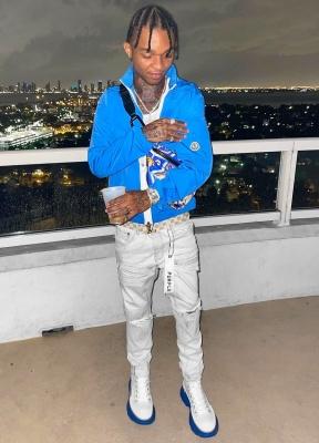 Swae Lee Wearing A Moncler Brize Jaket With A Lous Vuitton Belt Dolce Gabbana Belt Bag Purple Jeans And Alexander Mcqueen Sneakers