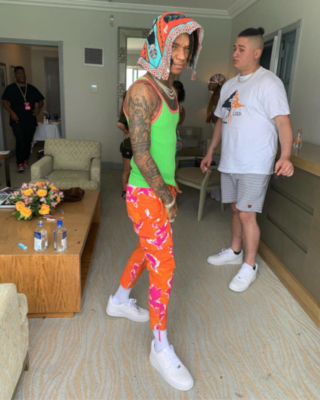 Swae Lee Wearing A Neon Green Tank Top With Orange And Pink Pants