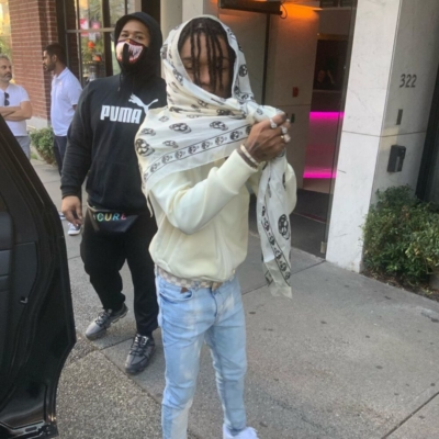 Swae Lee Wearing A White Comme Des Garcons Hoodie With An Alexander Mcqueen Scarf Creme Louis Vuitton Belt And Jeans