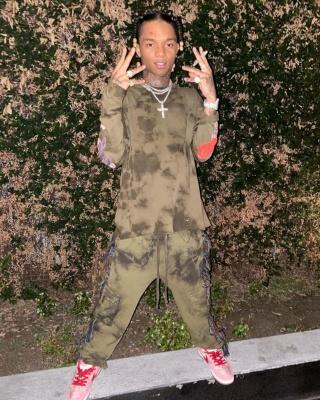 Swae Lee Wearing An Alchemist Olive Green Tie Dye Long Sleeve Tee And Fringe Sweatpants With Nike X Strangelove Dunks