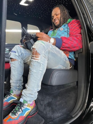 Tee Grizzley Wearing A Gucci Multicolor Gg Zip Hoodie And Sneaekrs With Amiri Jeans