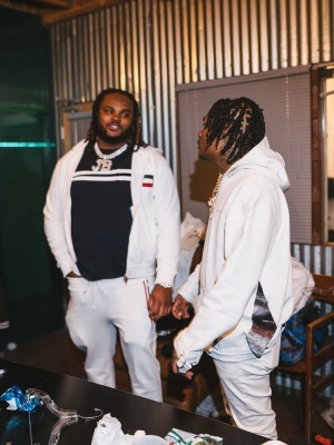 Tee Grizzley Wearing A White Moncler Zip Hoodie And Sweatpants
