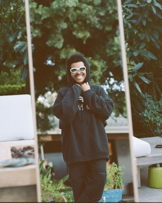The Weeknd Wearing Bottega Veneta Sunglasses And A Raf Simons Life On Mars Hoodie