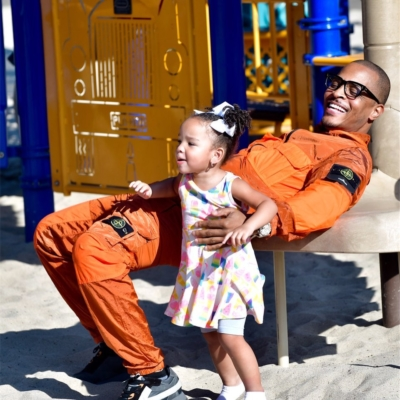 Ti Spending Time With His Daugher In An Stone Island Orange Jacket And Pants With Off White Sneakers