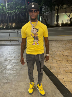 Toosii Wearing A New Era Black Dodgers Hat With A Palm Angels Tee Grey Jeans And Jordan Yellow Sneakers