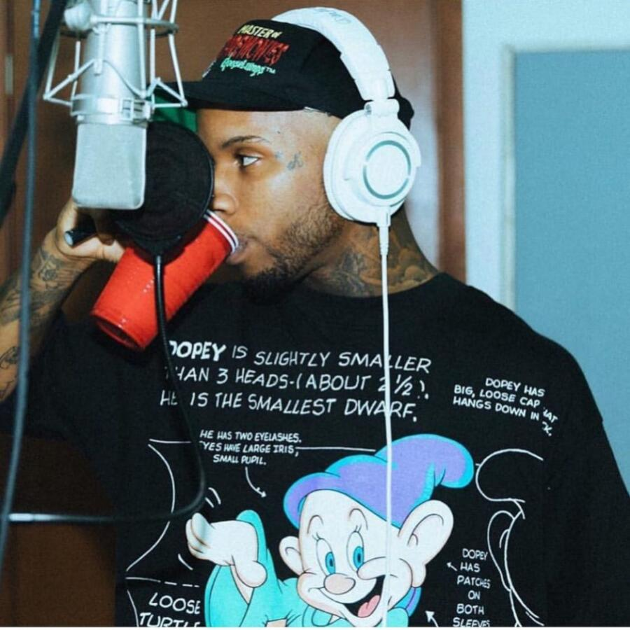Tory Lanez Wearing A Vintage Dopey Shirt And A Black Hat