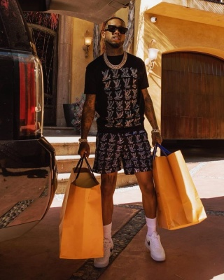 Tory Lanez Wearing Black Louis Vuitton Sunglasses Cartoon Tee And Cartoons Swim Shorts With White And Black Air Force 1s
