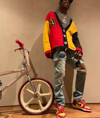 Travis Scott Wearing A Cactus Jack X Cpfm X Mcdonals Cardigan Kapital Jeans And Orchard Street Dunk High Tops
