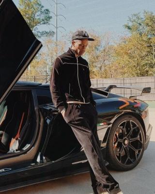 Travis Scott Wearing A Celine Black Velvet Track Jacket And Black Velvet Trackpants