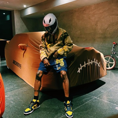 Travis Scott Wearing A Jackboy Helmet Cactus Jack Fleece And Jordan 1s