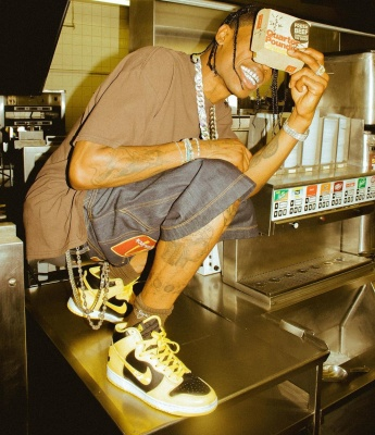 Travis Scott Wearing Cactus Jack X Mcdonals T Shirt And Shorts With Nike Dunk Hi Wu Tang Sneakers