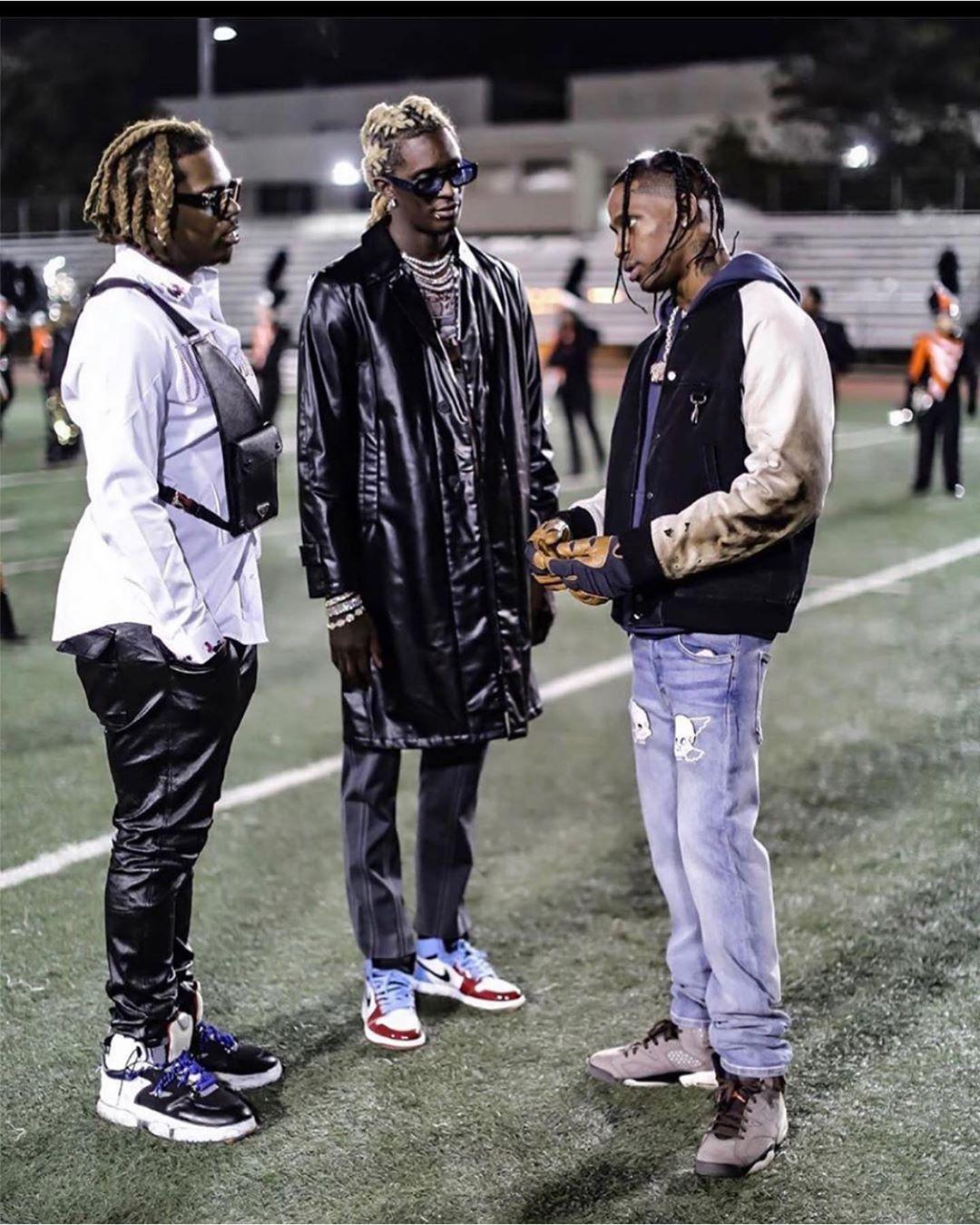 Travis Scott Wearing Lost Daze Jeans With A Reese Xooper Jacket And Jordan X Travis Scott Sneakers