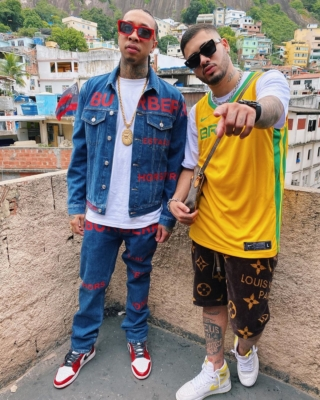 Tyga In Brazil Wearing Burberry Jeans And Jacket With Lv 1.1 Sunlgasses