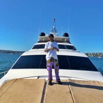 Tyga In Sydney Australia Wearing A New Era Sf Giants Snapback And Palm Angels Purple Tie Dye Pants