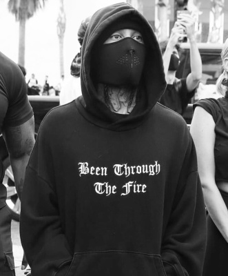 Tyga Protesting In L.a. In An Amiri Throught The Fire Hoodie