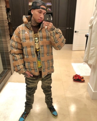 Tyga Wearing A Burberry Tape Coat And Nike Undefeated Dunks
