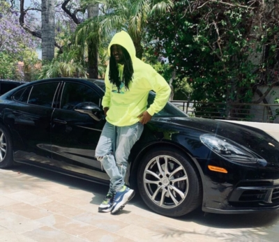 Wale Posted On His Panamera Wearing A Yellow Hoodie Fog Jeans And Dior Sneakers