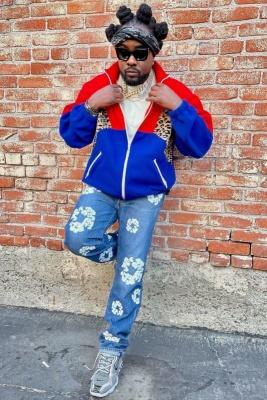 Wale Wearing A Celine Fleece Jacket With Denim Tears X Levis Jeans And Nike Air Spiridgon Sneakers