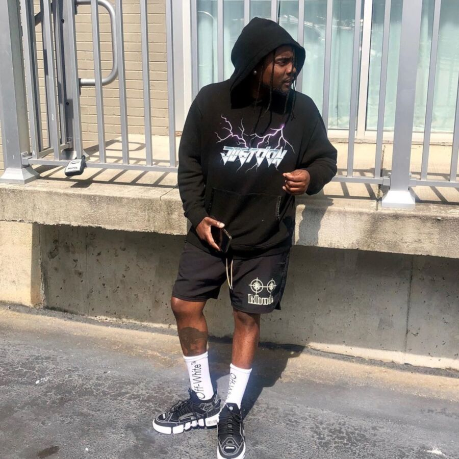 Wale Wearing A Just Don Black Hoodie Black Bodega Shorts Off White Socks And Black Sneakers