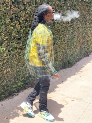 Wale Wearing A Raf Simons Double Layered Shirt With Black Pants And White And Blue Jordans