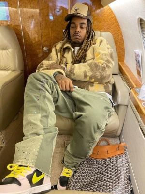 Wheezy Wearing A Cactus Jack Sweater With Nike Dunk Sneakers And A Goyard Steamer Bag