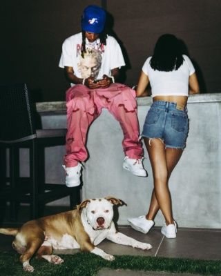 Wiz Khalifa Chills With Dog In Dennis Rodman T Shirt Expos Hat And Jordan 4s