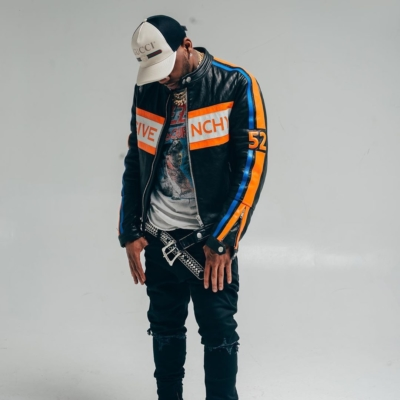 Yfn Lucci Wearing A Black Givenchy Leather Jacket Black Jeans Orange Converse Sneakers And Gucci Hat