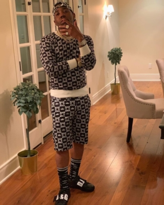 Yfn Lucci Wearing A Dolce And Gabbana Sweatshirt Shorts Socks And Sneakers