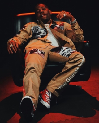 Yfn Lucci Wearing A Takahiro Miyashita Khaki Jacket And Pankts With Red High Top Converse