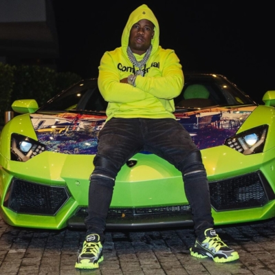 Yo Gotti Sits Atop His Aventador In A Marcelo Burlon Hoodie Amiri Jeans And Valentino Sneakers