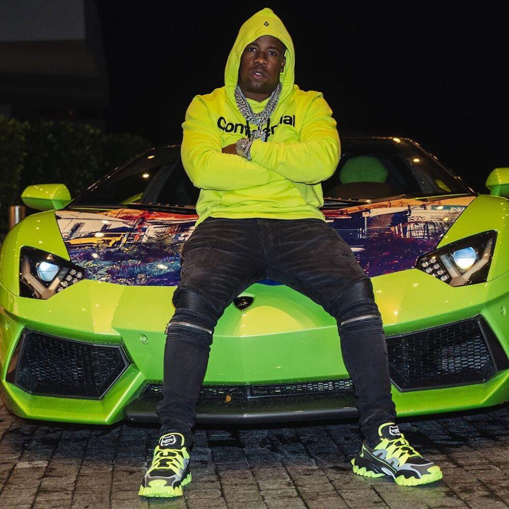 Yo Gotti Sits Atop His Aventador In A Marcelo Burlon Hoodie Amiri Jeans And Valentino Sneakers