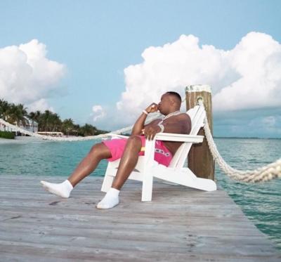Yo Gotti Weaing Pink Xtg Shorts Near The Ocean