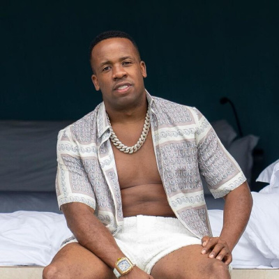 Yo Gotti Wearing A Dior Silk Shirt And Shorts With A Richard Mille Watch