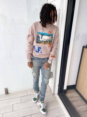 Yound Ma Wearing A Heron Preston Logo Sweatshirt With Nike Dunk Low Top Sneakers