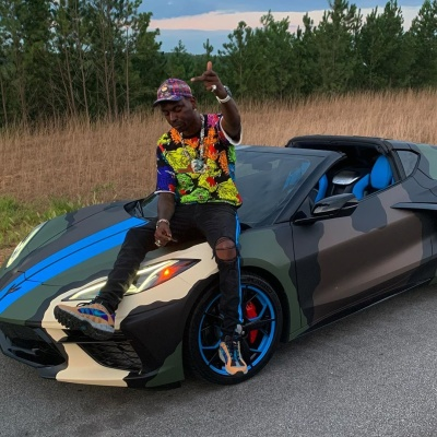 Young Dolph Sits Atop His Corvette In A Gucci Sweatshirt And Hat Amiri Jeans And Nike Air Humaras