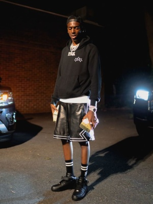Young Dolph Wearing A Black Star Hoodie With Amiri Shorts And Socks And Black Nike High Top Air Force 1 Sneakers