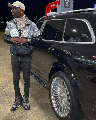 Young Dolph Wearing A Dolce And Gabbana Hat Sweater Jacket And Sneakers
