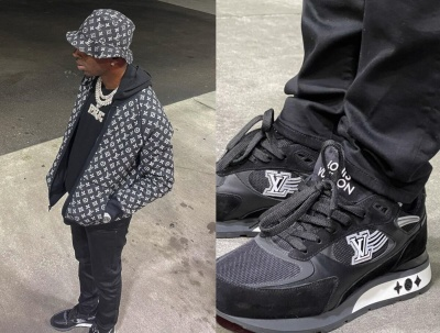 Young Dolph Wearing A Lv Bucket Hat And Jacket With Black Jeans And Sneakers