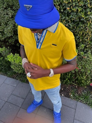 Young Dolph Wearing A Prada Bucket Hat Prada Yellow Polo Light Jeans And Jordan X Just Don Sneakers