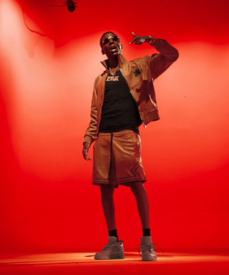Young Dolph Wearing An Amiri Brown Leather Jacket And Shorts With Jordan X Off White Sneakers