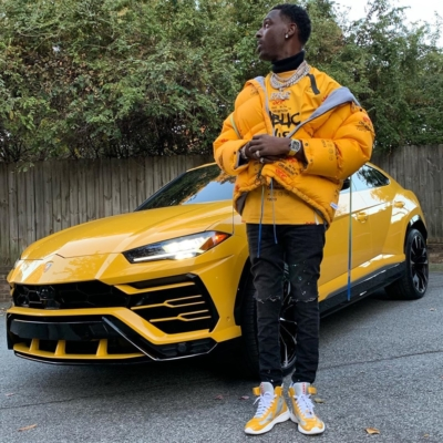 Young Dolph Wearing An Off White Coat And Tee With Amiri Jeans And Prada Sneakers