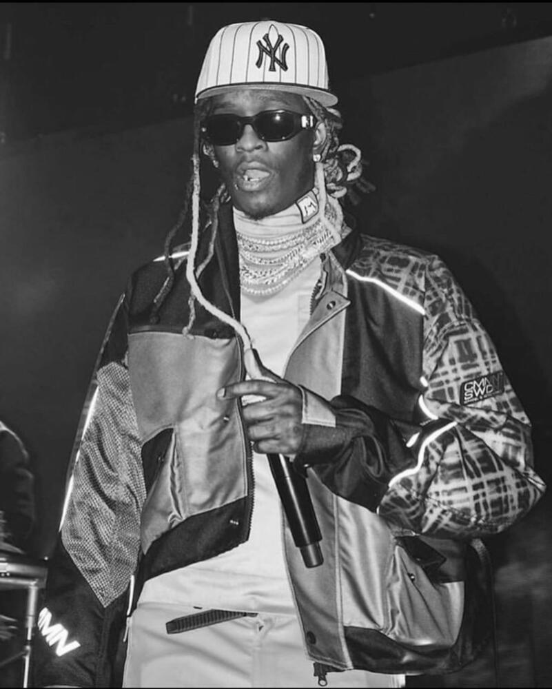 Young Thug Wearing A Cmmn Swdn Jacket And A Pinstripe Yankees Hat