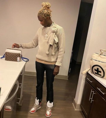 Young Thug Wearing A Louis Vuitton Teddy Sweater Black Pants Rick Owens Sneaekers A Lvxnba Nil Messenger Bag